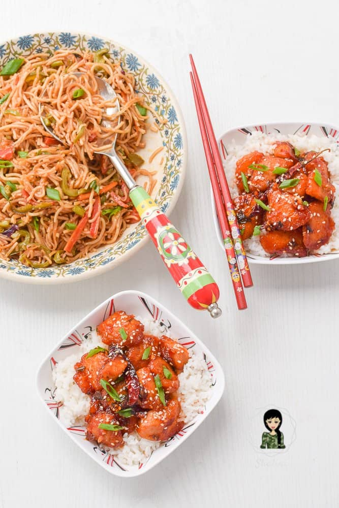 Honey sesame chicken with rice and asian noodles