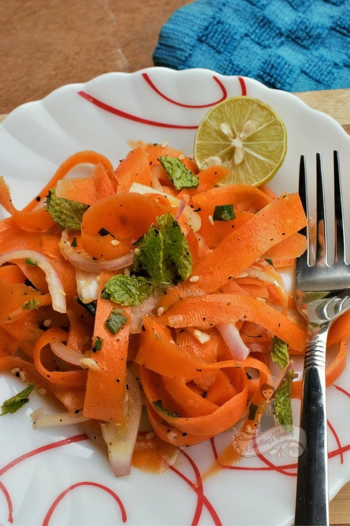 Spicy carrot ribbon salad with honey sesame dressing
