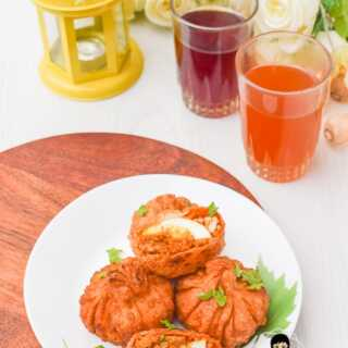 a plate of kerala turkey pathiri for ramzan iftar snack with sulaimani tea