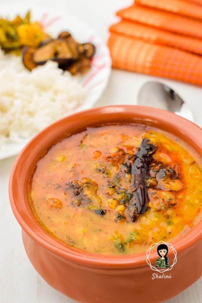 A bowl of Dal Tadka or Dal Fry with roti, rice and sabji
