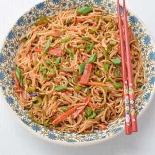A bowl of veg chow mein with chopsticks