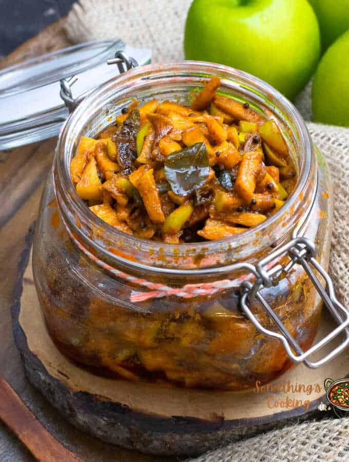 green apple pickle kerala style in a glass jar